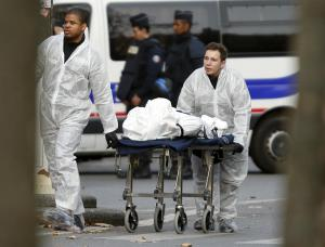A victim is wheeled out of the Bataclan concert hall the morning after a series of deadly attacks in Paris, November 14, 2015. REUTERS/Charles Platiau